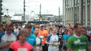 ST. PETERSBURG, RUSSIA - 09. 07. 2017. People running the marathon in city center. Men and women doing sport at festival.