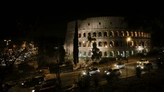 Stop motion video of the Colosseum in Rome, Italy in the evening. View on the traffic road and light from the sight.