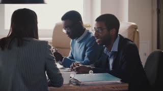 Successful African American CEO businessman leading a job interview at mixed ethnicity modern healthy office slow motion