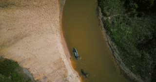 Tourists enjoying boat trip on small river turn. Two friends canoeing tour. Flyover aerial drone 4k. Peaceful retreat.