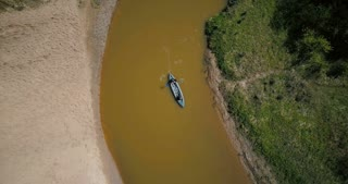 Tourists enjoying kayaking on small river turn. Two men paddling boat. Top view aerial drone 4k. Peaceful quiet retreat.