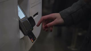 Woman s hand enter ATM banking cash machine pin code or password, then pull out the credit card. Close-up, 4K