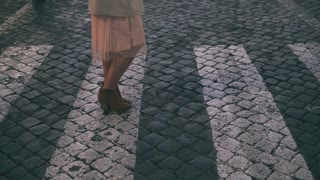 Young beautiful woman walking in Piazza di spagna in Rome, Italy. Girl goes to Saint Peter Cathedral. Slow motion.