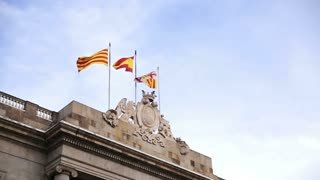 Waving flags of Spain and Catalonia