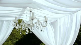 Wedding decorations. crystal chandelier on a arch