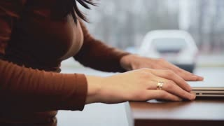 Woman comes, opens the laptop and starts working