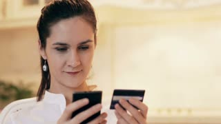 Woman shopping online with mobile phone at home