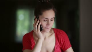 Woman talking on the phone at home.
