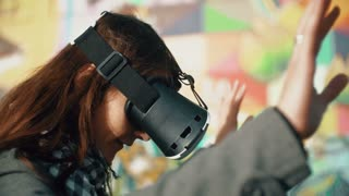 woman uses a virtual reality glasses on a bright background 4k