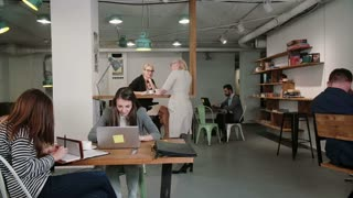 Woman uses laptop finds out good news everyone is happy congratulate and applaud her. business team in startup office