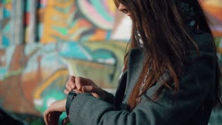Woman using her smartwatch touchscreen device on a bright background 4k