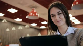 woman using tablet computer touchscreen in cafe