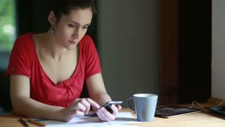 woman working and using smartphone drink coffee