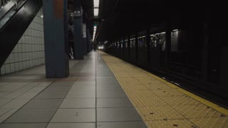 A view of the subway in New York City. The hustle and bustle of travel the metropolitan center of New York. The public transportation in the subway tunnel is a popular mode of transport.