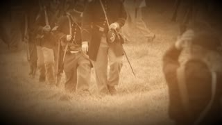 Civil War soldiers marching across field (Archive Footage Version)