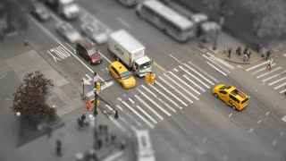 Desaturated tilt shift aerial view of a city intersection
