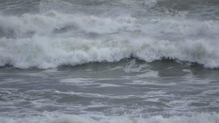 Slow motion waves cascade on beach