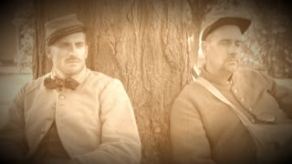 Two tired Civil War soldiers resting by tree (Archive Footage Version)