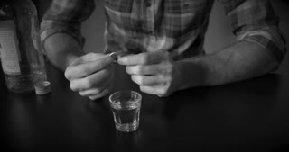 Man drinks alcohol thinking of divorce black and white