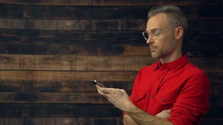 Stylish man using handheld device
