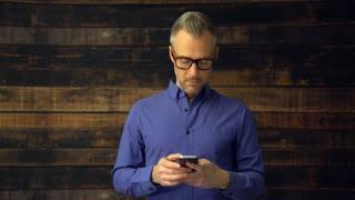 Thoughtful man using phone device