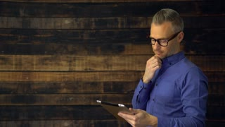Thoughtful man using tablet device