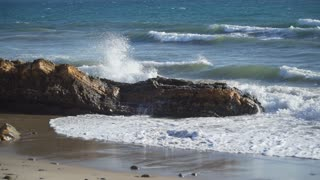 Waves hitting rocks on beach near Point Conception State Marine Reserve