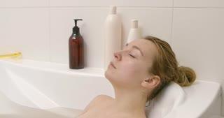 Beautiful woman sleeping in bath.