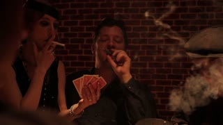 1920s Prostitute And Gangster Smoking And Playing Cards