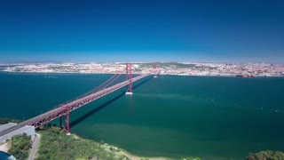 25th of April Suspension Bridge over the Tagus river, connecting Almada and Lisbon in Portugal timelapse 4K wide angle lens