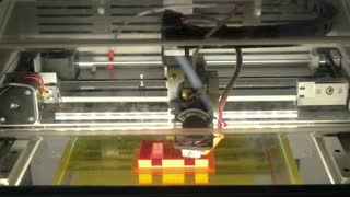 3D printer making letter E. Modern technologies in production of three-dimensional objects