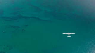 4K Aerial Air to Air of Plane Flying Over Lake Tahoe