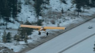 4K Aerial Air to Air of Plane Over Highway and Forest