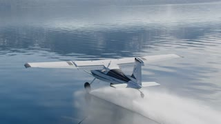4K Aerial Air to Air of Small Plane Flying on Lake Tahoe