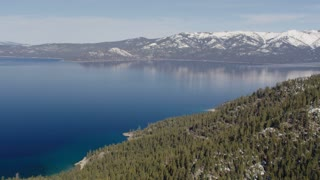 4K Aerial Flying Over Forest Towards Lake Tahoe