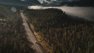 4K 60fps Aerial of RV Driving on Icefields Parkway in Jasper Birds Eye