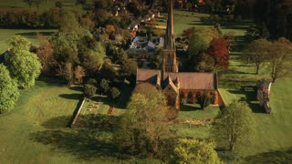 4K Aerial Flying away from Church in English Countryside