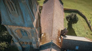 4K Aerial flying over Church in English Countryside