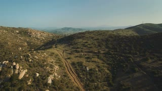 4K Aerial Flying over Hills and Into California Suburb