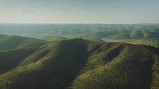 4K Aerial Flying Over Rolling Green Hills