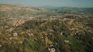 4K Aerial Flying Over Small Country Town