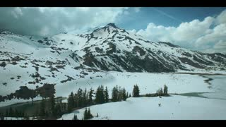 4K Aerial Flying Over Snowy Mountains