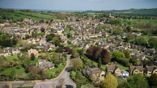 4K Aerial flying over Village in England