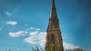 4K Aerial flying towards Church in English Countryside