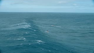 4K Aerial shot of Surfer Riding Wave