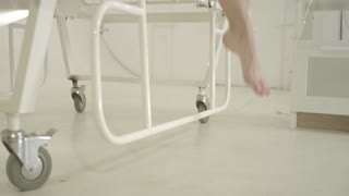 4k Closeup shot of female feet under hospital bed. Concept shot of recovery after illness.