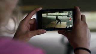 4K Male breakdancer dancing whilst being recorded on a smart phone, shot on Red Epic Dragon