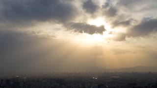 4k resolution Sun beams above city