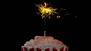 4K Sparkler burning until it dies out on a large cupcake