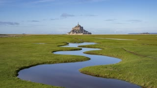4K Timelapse sequence of The 'Mont Saint-Michel' and the small the River 2304